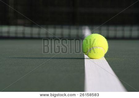 Tennis ball on a court line