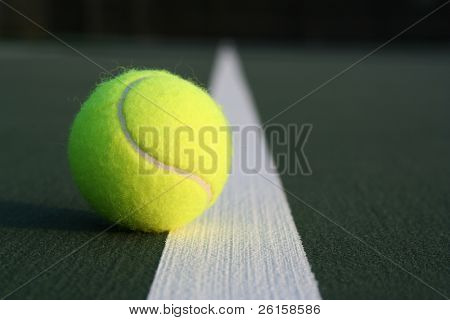 Close up of a tennis ball on the court