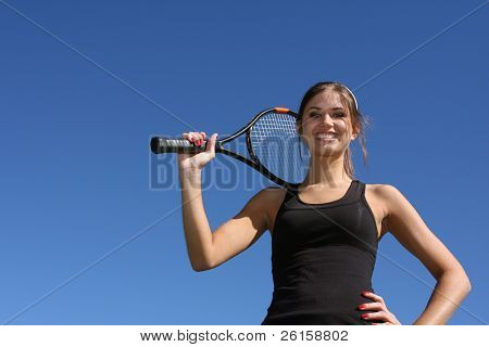 Pretty Brunette Female Tennis Player holding her racket