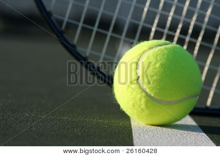 Tennis ball and the racket