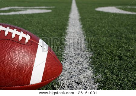Football near the yard line on a field