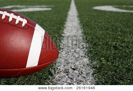 American Football close up with the Fifty Yard Line Beyond