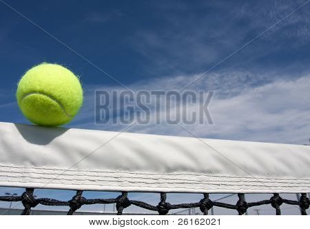 Tennis Ball on the Court Net with room for copy