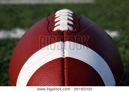 American Football close up with yard lines beyond