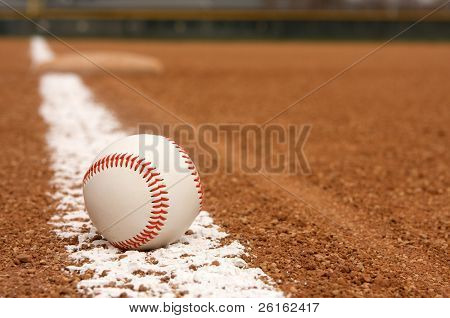Baseball on the Infield Chalk Line with Third Base beyond