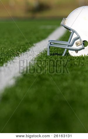 American Football Helmet on the Field with room for copy, shot with shallow depth of field