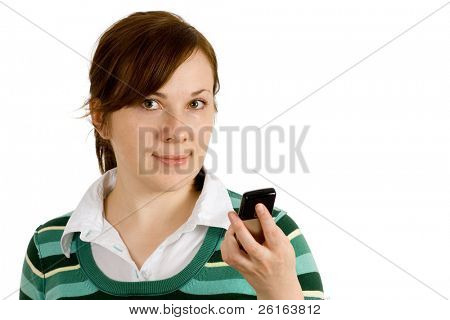 young female reading text message on her mobile phone, looking into camera, holding mobile phone on her hand
