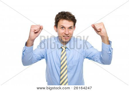 young businessman in his 20s, wears blue shirt with yellow necktie, holds arms up celebrate success, studio shoot isolated on white background