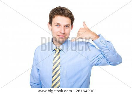 young businessman making 'call me' or 'on the phone' gesture, studio shoot isolated on white background