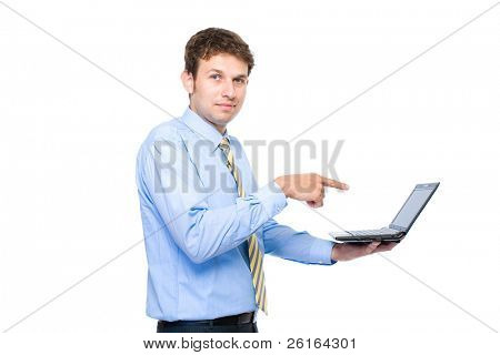 young businessman, it specialist points to screen of small laptop or netbook computer, studio shoot isolated on white background