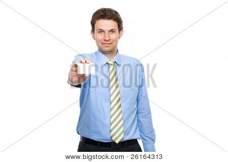 young businessman holds businesscard, only card and hand are in focus, face is lightly blurred, studio shoot isolated on white background