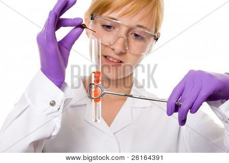 young attractive research student, chemist or lab assistant, making some tests with red liquid in pipette and test tube, studio shoot isolated on white background
