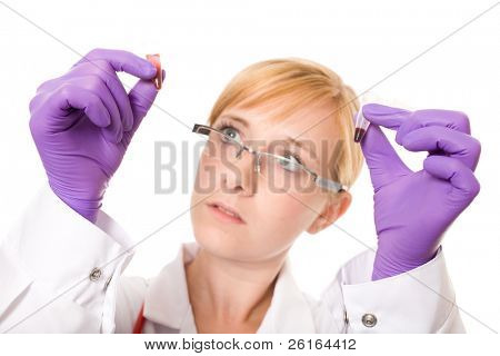 young female doctor compare two samples of blood in small test tubes, studio shoot isolated on white background