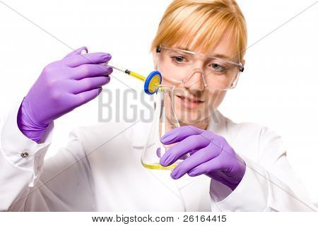 young female doctor, nurse or research laboratory assistant taking some samples of yellow liquid, from syringe through small filter, studio shoot isolated on white