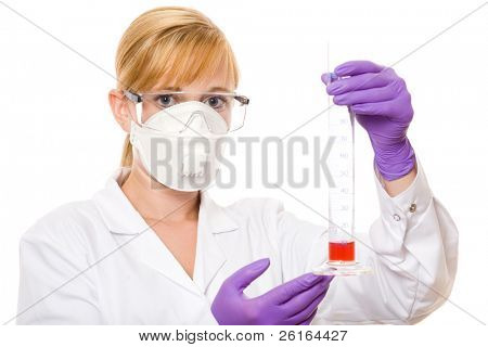 young blonde female scientist in protective goggles, mask and gloves holds test tube with red liquid, studio shoot isolated on white