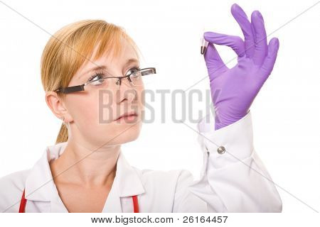young female doctor checks carefully sample of blood in small test tube, studio shoot isolated on white background