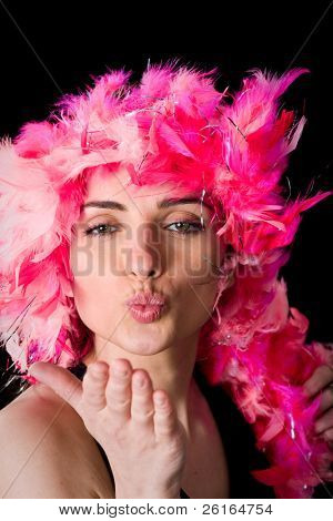 very attractive female sends kiss towards camera, pooch, studio shoot isolated on black background