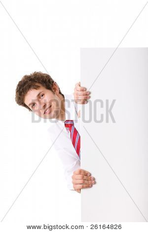 businessman hidden behind large copyspace card, holds it from side, only his head and arms are visible, studio shoot isolated on white