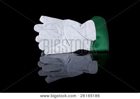 garden or industrial green safety gloves, studio shoot isolated on black with reflection