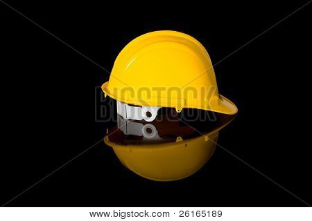 yellow safety hard hat, right hand side shoot, studio shoot isolated on black with reflection