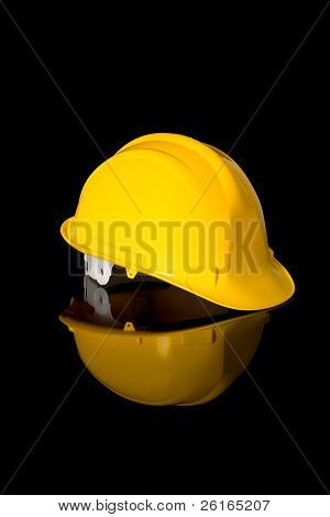 yellow safety hard hat, right hand side angle shoot, studio shoot isolated on black with reflection