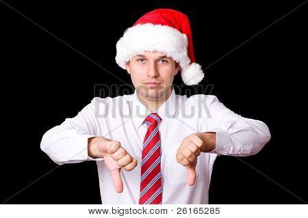 santa shows thumbs down gesture, sad christmas concept, studio shoot isolated on black