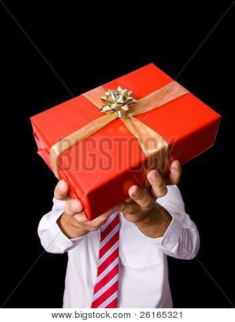 male hand holds red gift, christmas or valentine day concept