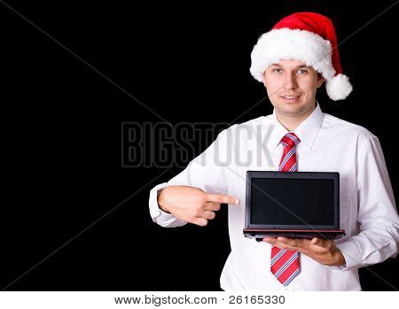 young santa in shirt and necktie use small netbook, online christmas shopping concept, studio shoot isolated on black