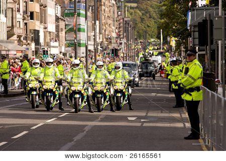 EDINBURGH, SCOTLAND, UK - SEPTEMBER 16: Group of Police motorbikes from Pope Benedict XVI escort during parade on September 16, 2010 in Edinburgh, Scotland, United Kingdom. Popemobile behind them.