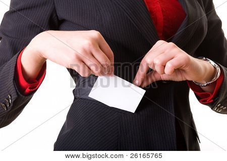 businesswoman takes her business card out of her suit pocket, isolated on white