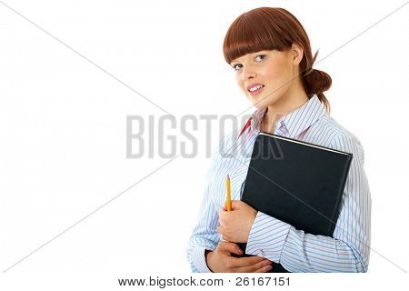 redhead female holds big black notepad and yellow pencil, isolated on white