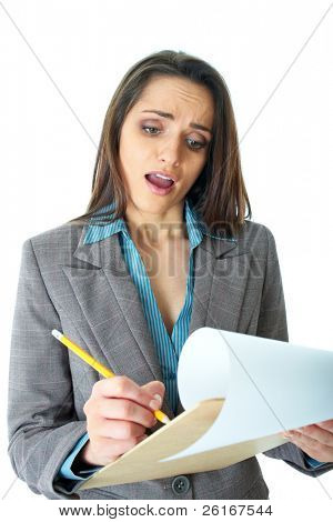 young attractive but shocked businesswoman makes some notes or calculation with pencil and paper on wooden board, isolated on white background