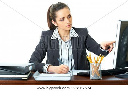 attractive office make some notes while looking at computer screen, busy preparing some document, isolated on white