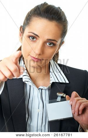 young attractive businesswoman holds her badge and point with her finger to camera, isolated on white