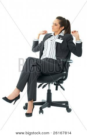 tired office worker sits in her chair and stretch her arms, isolated on white