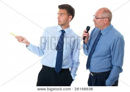 two businessman in blue shirt during seminar presentation, one point to left with yellow pencil, the other speaks to microphone, isolated on white