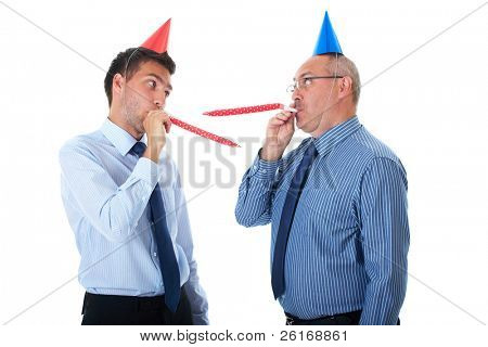 two office workers, junior and senior one wears paper party hats, isolated on white