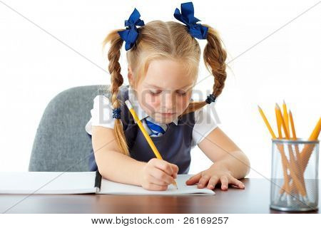 Blonde happy schoolgirl works on her homework, learn to write, isolated on white