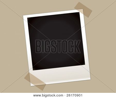 Foto instantánea en blanco con dos esquinas con cinta