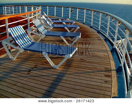 Deck chairs on cruise ship overlooking the ocean