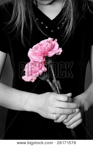 Closeup of girl with long hair holding flowers in her hands