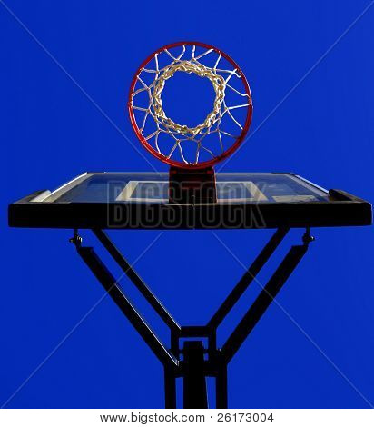 Basketball hoop and net with blue sky in background