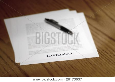 Contract lying on desk with pen