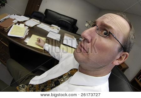 Surprised looking man in business office