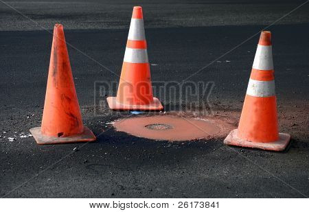 Roadwork with Orange Pile On Markers in the Street