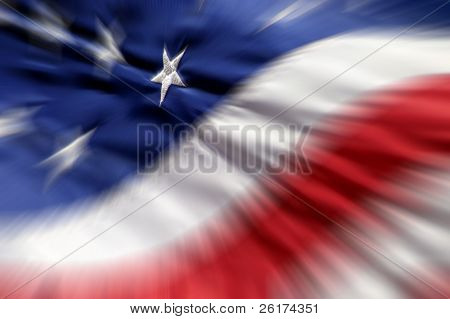 Detail closeup of American Flag with focus on one white star