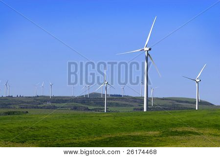 Many windmills generating power on hillside