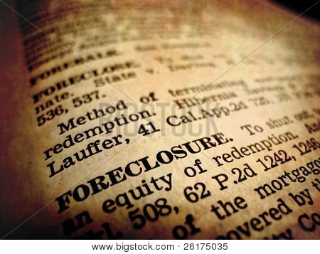 Definition of foreclosure in dictionary book on pages with type