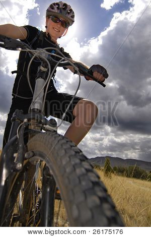 Young Woman Riding Mountain Bike in Wilderness