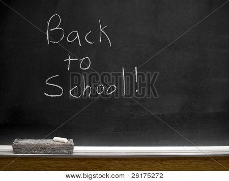Chalkboard with back to school written in white chalk